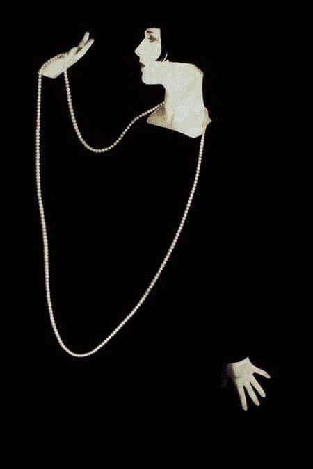 Louise Brooks in black with pearls